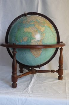 Decorative old globe in wooden globe chair - middle of 20th century