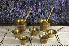 Lot of 7 metal  mortars with their maces.