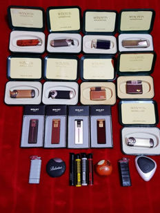 collection of 22 lighters pack: 15 WINJET International Lighters Made in Switzerland with original boxes + 5 Champ Lighters + 2 Ballantine's Lighters