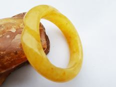 Carved Baltic Amber bracelet bangle eggyolk butterscotch colour, 42 grams