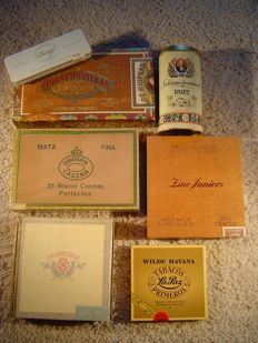 Various cigar boxes and old tobacco packages.