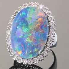Stunning seventies ring with one big triplet opal and 30 brilliant cut diamonds
