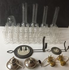 Collection of oil lamp cylinders, holders and burners