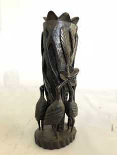 Heavy African wood carving, decorated with cranes