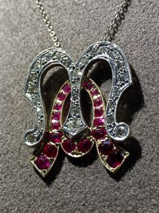 Gold pendant with initials 'M. A.' featuring diamonds and rubies, with white gold chain necklace. Central piece: 2 cm x 2 cm, 5.48 g.