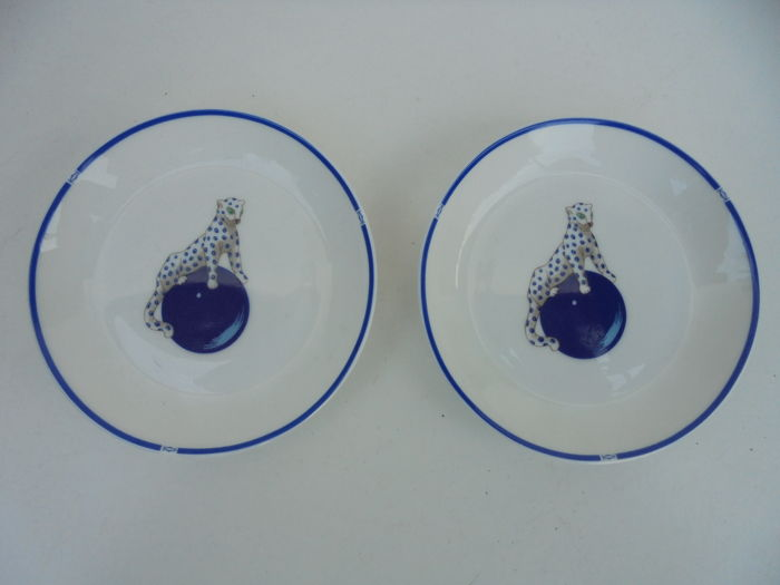 Pair of porcelain saucers signed Cartier