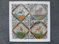 Four square tiles from Zeeland on a plate