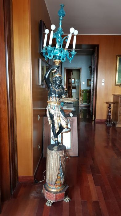 A polychrome and gilt carved wood sculpture of a Moor - mounted with a Murano glass candlestick - Venice, Italy - circa 1900/1920