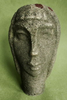 Monogram 'O.K' - styled women's head, concrete