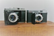 Two vintage Voigtländer folding cameras, a Voigtländer Perkeo I and a Voigtländer Vito II A made in the 1950s