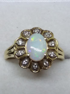 Antique old mined Australian Opal with 10 old rose cut diamonds in 14k yellow gold.