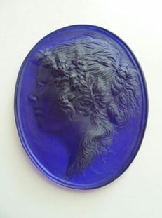 Glass wall medallion, France, early 20th century