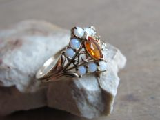 Gold Ring with 1x Gold Fire Opal (approx. 0.19 ct) and 10x Fire Opal (approx. 0.56 ct)