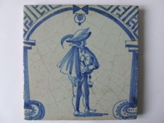 A rare gate tile with a jester and a 'Foeke' friction drum