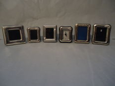 5 silver-plated frames and 1 800 silver clock