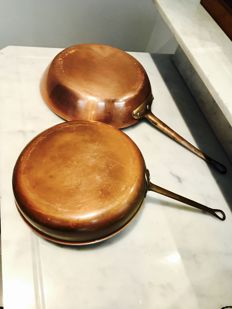 large copper pans with bronze handles