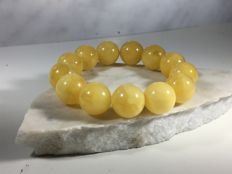 Baltic Amber egg yolk yellow opaque bracelet, 35 grams