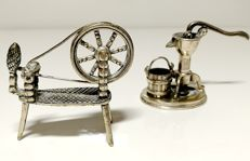 Two small sculptures of work tools and turning wheel in silver, Italy, 20th century