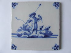 Antique tile with shepherd-falconer