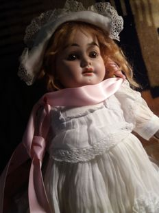 Beautiful late 19th century doll. Open mouth. Real hair. Probably French