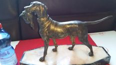 Large Bronze-Plated Hunting Dog with Pheasant In Its Mouth