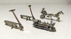 Lot of four small miniatures in silver, Italy, 20th century - two scooters, a train and a man with galloping horse