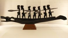 Beautiful African sculpture of a wooden dragon canoe with 7 warriors, Congo