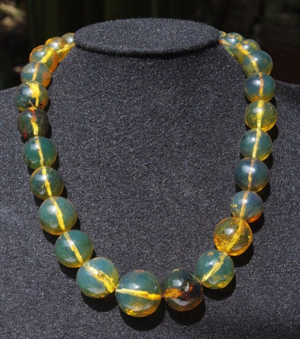 green fluorescent Amber beaded necklace, very rare