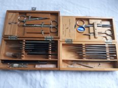 Essential surgical instruments, 20th century, including Stopler