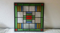 Beautiful colourful stained glass window in Art Deco style