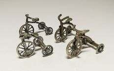 Four small silver tricycles, 20th century, Italy