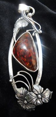 Large silver vintage pendant with a Baltic Amber