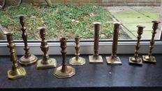 A lot of 9 pieces of bronze and copper candlesticks - Western Europe - 18th to 20th century