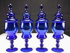 Four blown glass vases with lid from an antique pharmacy