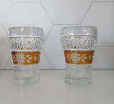 Two Bohemian cut amber-coloured crystal cup vases