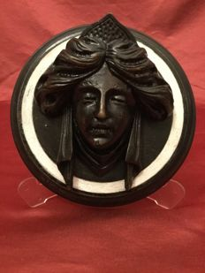Tile with ebonized wood high-relief depicting a female face - Italy - circa 1900