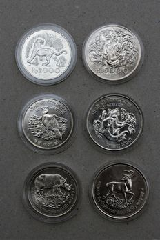Asia - Indonesia 2000 and 5000 Rupiah 1974, Nepal 25 and 50 Rupee 1974, Thailand 50 and 100 Bath 1974 - silver