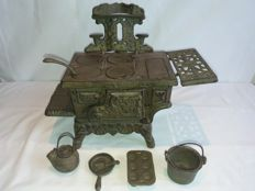 Crescent toy cast iron stove with accessories, 1950s