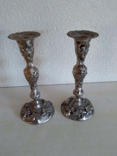 Two identical heavily silver plated candle stands