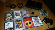 Playstation 2 with 7 games and controllers + memory card