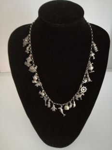 835/1000 silver 1960s/70s charm necklace with 21 charms