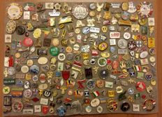 Collection of pins from various countries, various kinds.