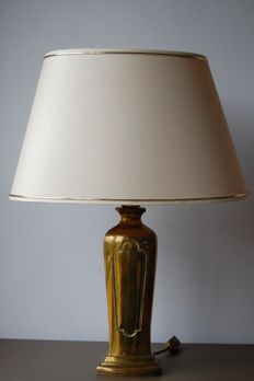 B. Lux - table lamp with a gold-coloured metal base.