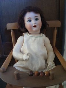 Antique character doll Schützmeister & Quendt 201 with chair - Germany