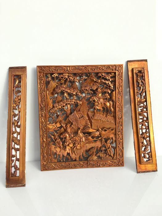 Three sculpted wooden decorations - China - end of the 19th century