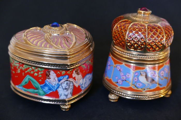 "Two music boxes in porcelain gilded in 24k fine gold, House of Fabergé, ""Nightingale"" and ""Raymonda"" models"