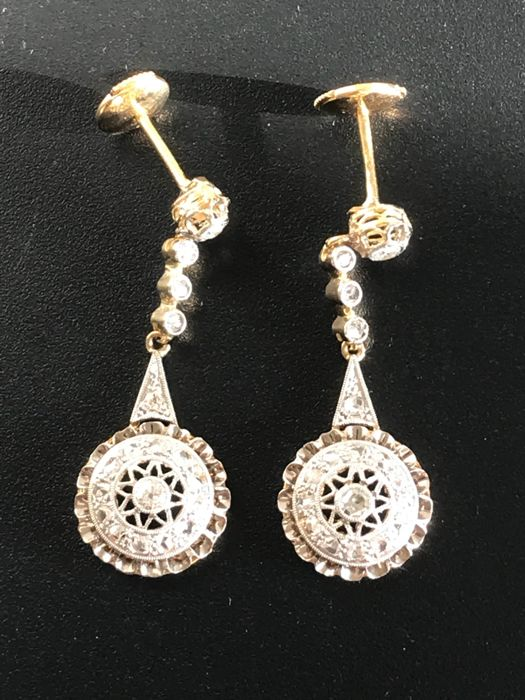 Art Deco earrings in gold and platinum, with diamonds totalling 1.10 ct (approx.).