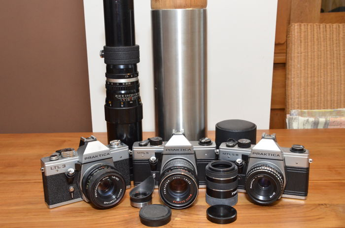 Three Praktica SLR cameras, the LTL 3, the MTL 5 and 5B with four lenses and extension tubes