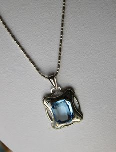 Vintage silver pendant set with rectangular blue stone in Aquamarine color and and beautiful Sterling silver chain.