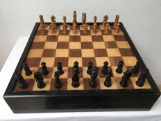 Antique chess set including checkers pieces